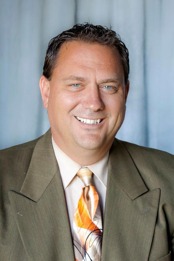 Michael L Passmore