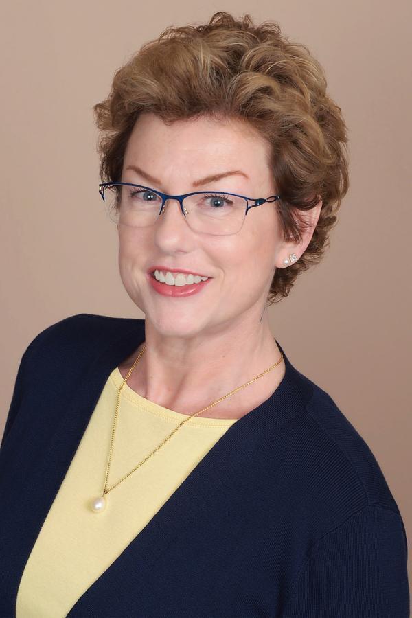 Kathleen E Clark