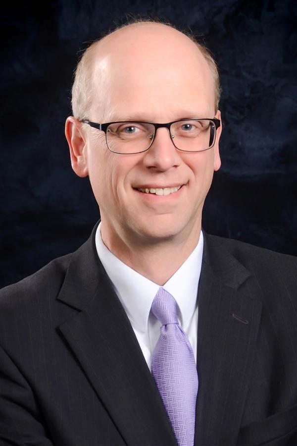 John M Krogstad