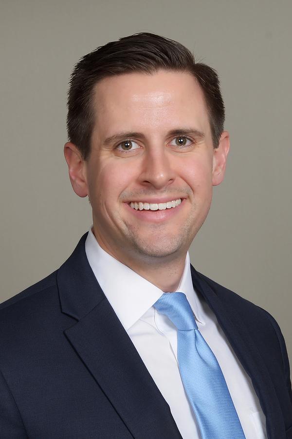 Eric C Simon