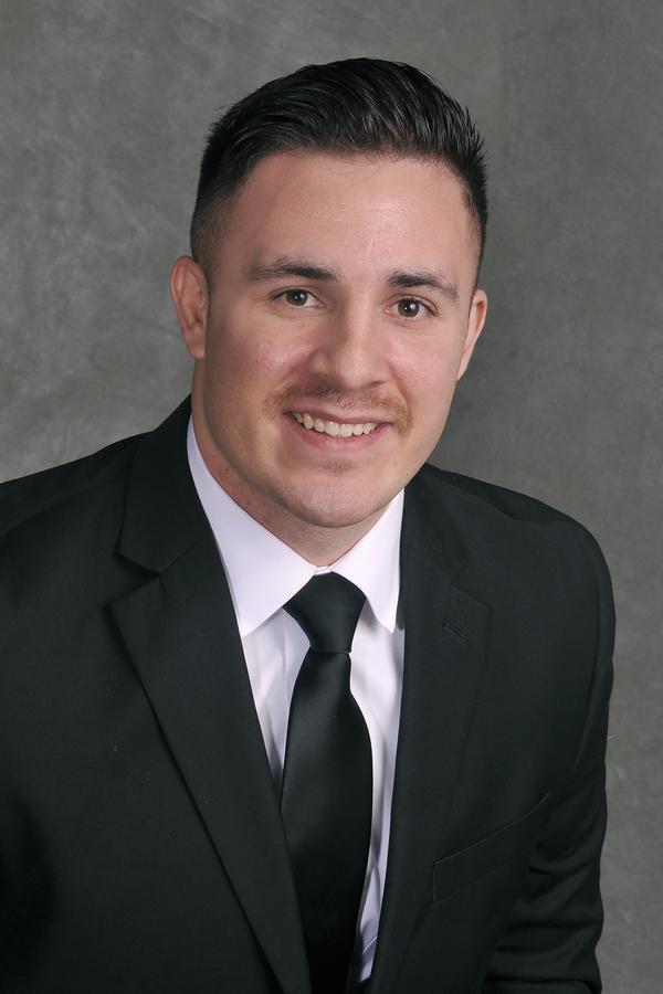 Adam T Caballero