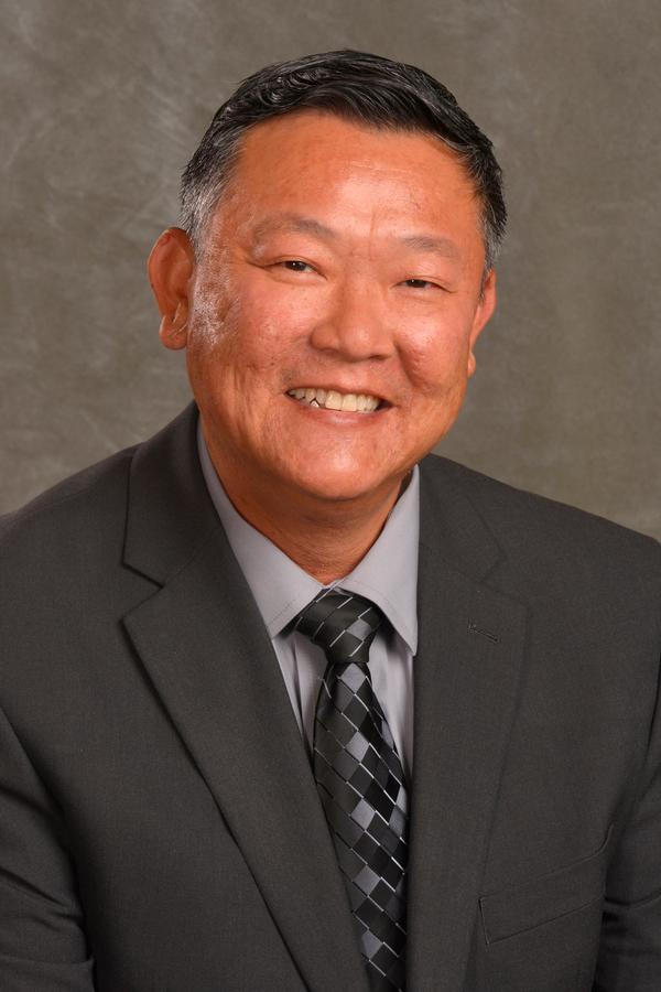 Albert C Mui