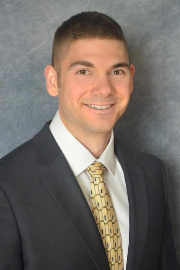 Adam M Tallcott